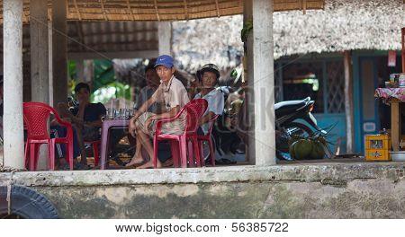 Vietnamese men enjoying tea time at Mekong Delta