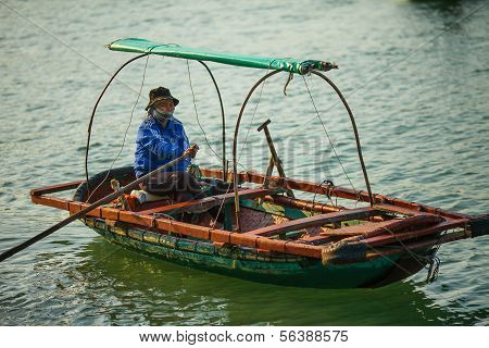 Vietnamese woman on passenger transfer boat in Ha Long Bay