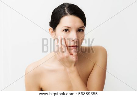 Young Woman Observing Facial Wrinkles