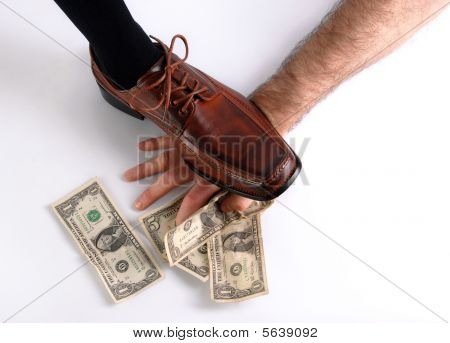 Shoe Crushing A Hand That Holds Money. White Background