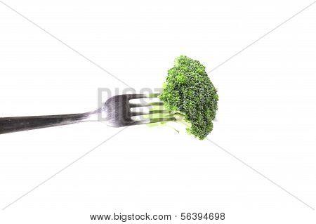 Flósculo brócolis num garfo.
