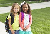 picture of little school girl  - Cute Little girls walking to school together - JPG