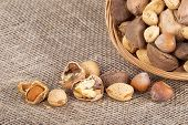picture of brazil nut  - Mixed nut basket with almonds walnuts pecans hazelnuts and Brazil nuts. Burlap background 