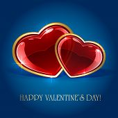 image of glass heart  - Blue valentines background with two glossy hearts - JPG