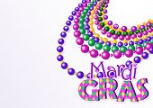 image of tartan plaid  - Mardi Gras beads background with place for text - JPG
