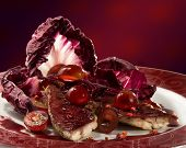 image of mullet  - Red mullet with red salad on a round plate - JPG