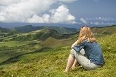 Young women at the summit of a mountain, Azores Islands