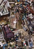 Top view of a junkyard with a chaotic load of wasted trash
