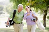 picture of golf bag  - Couple Enjoying A Game Of Golf - JPG
