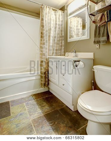 White And Brown Bathroom Interior