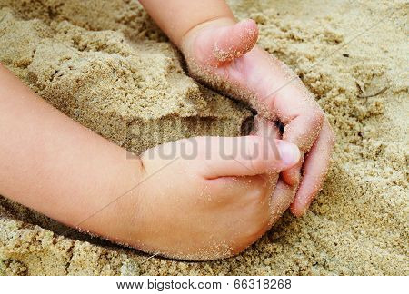 Child Playing in Sand at Beach