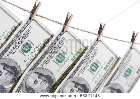 Hundred Dollar Bills Hanging From Clothesline on a White Background.