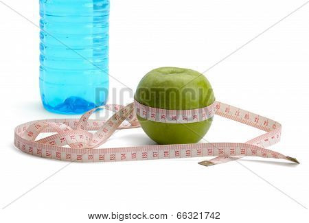 apple, a bottle of water and  tape