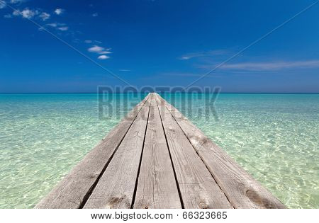 wooden pier stretching into the ocean