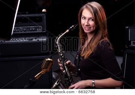 Young Female Play In Study On  Saxophone