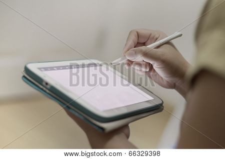 Hand Writing On A Tablet