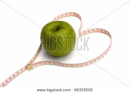green apple and a measurement tape , isolated on white background