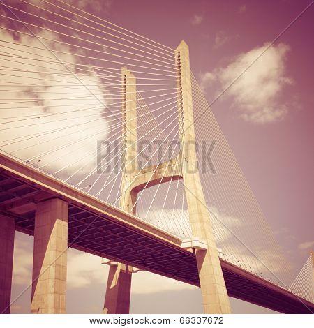 Vasco da Gama bridge in Lisbon, Portugal with retro effect.