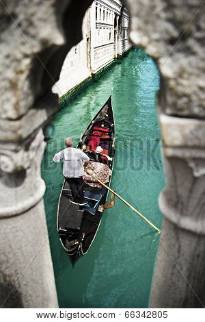 Gondola with gondolier under Bridge of Sighs in Venice, Italy