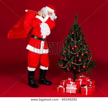 Santa Carrying Gifts In Sack