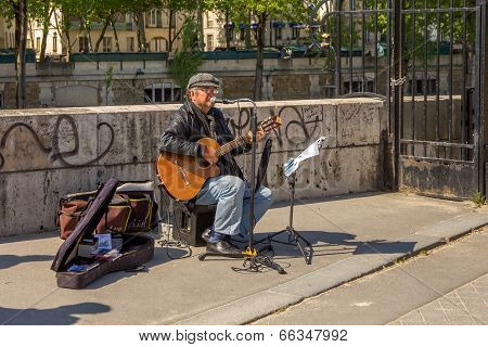 Busker Sings French Chanson In Paris