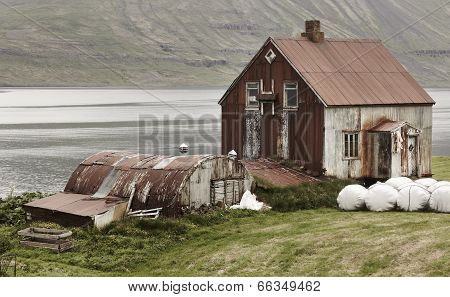 Iceland Landscape In Seydisfjordur. Abandoned Rusted Farm And Fiord.