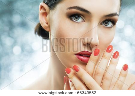 beautiful girl with red nails