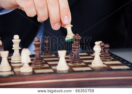Human Hand Playing Chess