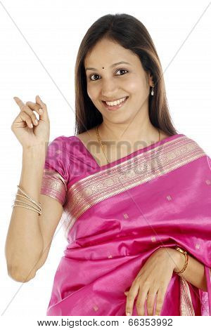 Young Indian Woman Showing Back With Her Index Finger