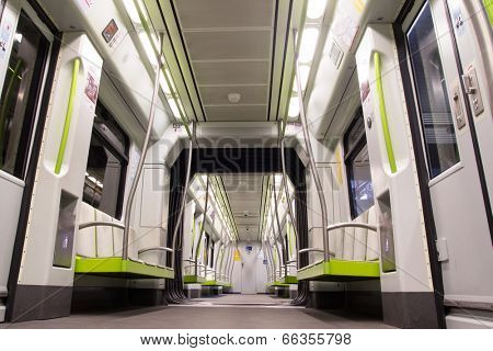 VALENCIA, SPAIN - JUNE 9, 2014: Inside a Metro subway car in Valencia. The  metro network consists of more than 134 kilometers (83 mi) of track, of which 19 kilometers (12 mi) is below ground.
