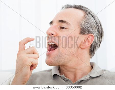 Man Applying Fresh Breath Spray