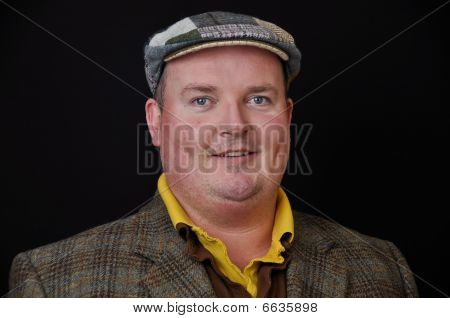 Male In His 30's Overweight On Black Background
