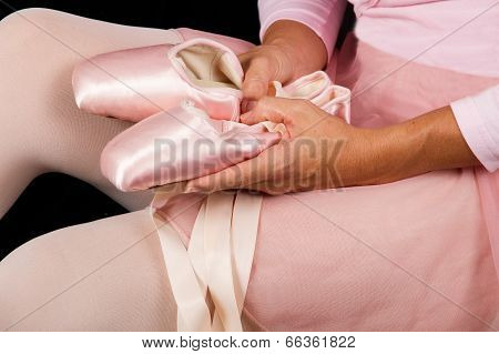 Ballerina Sit Down On Floor  Put On Slippers Prepare For Perform With Selective Focus