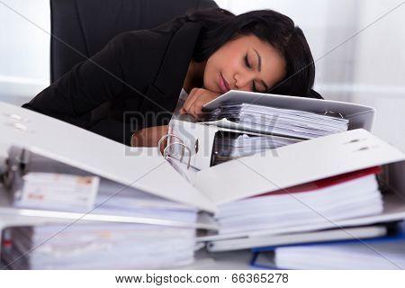 Businesswoman Sleeping On Piles Of Folders