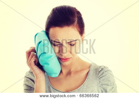 Young casual woman having a toothache