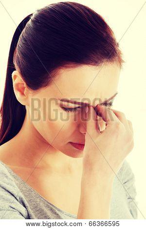 Young beautiful woman touching her nose
