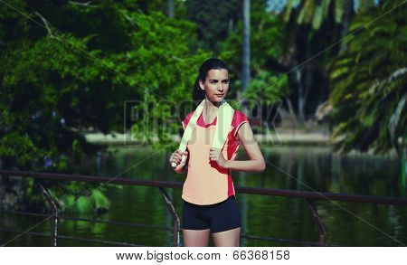 Attractive female runner resting after a morning run