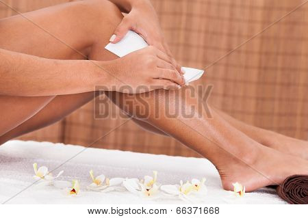 Young Woman Doing Depilation On Legs