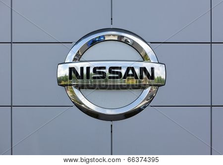 Dusseldorf, Germany - June 12, 2011: Nissan logo at the wall of car dealer's building. Nissan Motor Company Ltd is a multinational car manufacturer headquartered in Yokohama, Japan.
