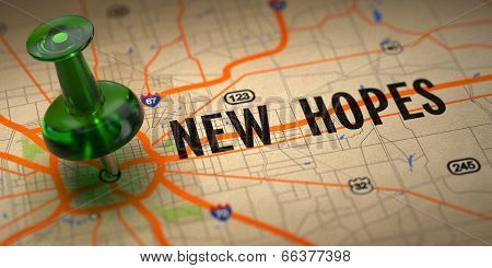 New Hopes - Green Pushpin on a Map Background.