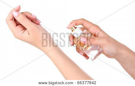 Bottle of perfume in hand isolated on white