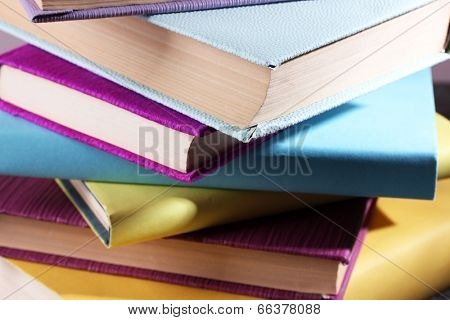 Stack of colourful hardback and paperback books, close-up