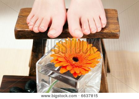 Feet on a stool