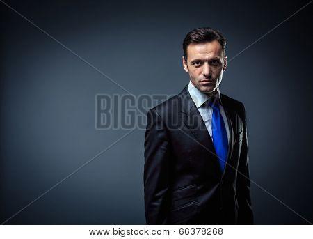 Business man in suit in studio