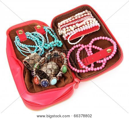 Handbag with accessorises isolated on white