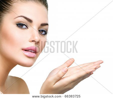 Beautiful Young Woman with Clean Fresh Skin close up isolated on white. Beauty Portrait. Spa Woman Smiling and open hands. Perfect Fresh Skin. Pure Beauty Model. Youth and Skin Care Concept