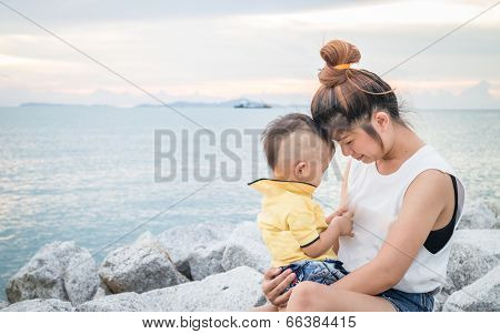 Cute Asian Boy Playing With His Mother