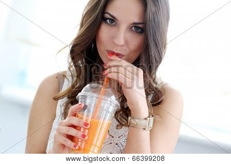 Cute, attractive woman with orange juice
