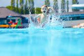 picture of jumping  - happy boy kid jumping in the pool - JPG
