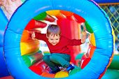 image of daycare  - happy kids playing on inflatable attraction playground - JPG